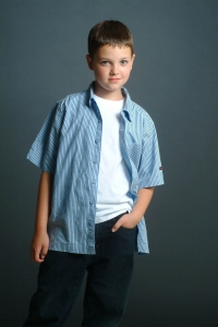 Photograph of a young boy with a blue shirt