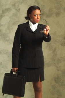 Photograph of a beautiful lady in a business suit with briefcase