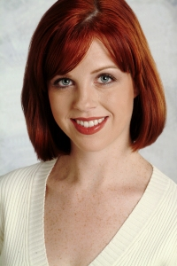 Headshot of a beautiful girl with red hair